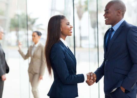 African-American-professional-business-people-handshaking-in-office