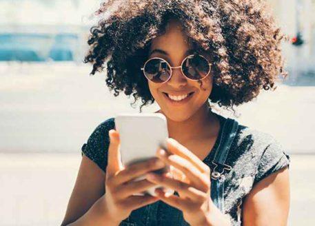 summer_girl_checking_phone-mobile